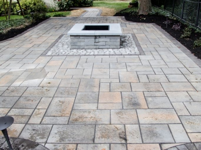 We are one of the top stone patio installation companies in Harrisburg PA. This image shows a top down view of one of out recent projects including fireplace installation.