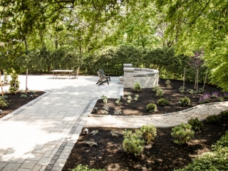 This is an image of a walkway project we did in Camp Hill PA recently. This image shows two beautiful walkways with two different materials. There are chairs surrounding a fire pit.