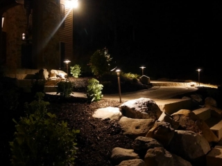 This is a landscape installation project our companies completed in harrisburg pa. This image shows new landscape design being illuminated with lighting.