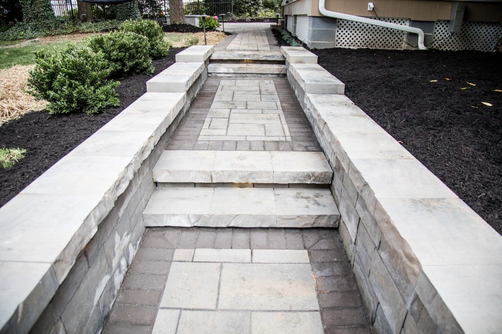 This is a close shot of an outdoor walkway project we completed recently. As installers in Camp Hill PA and the surrouding areas, we know how to impress. Either side of the walkway has fresh mulch surrounding the plants.