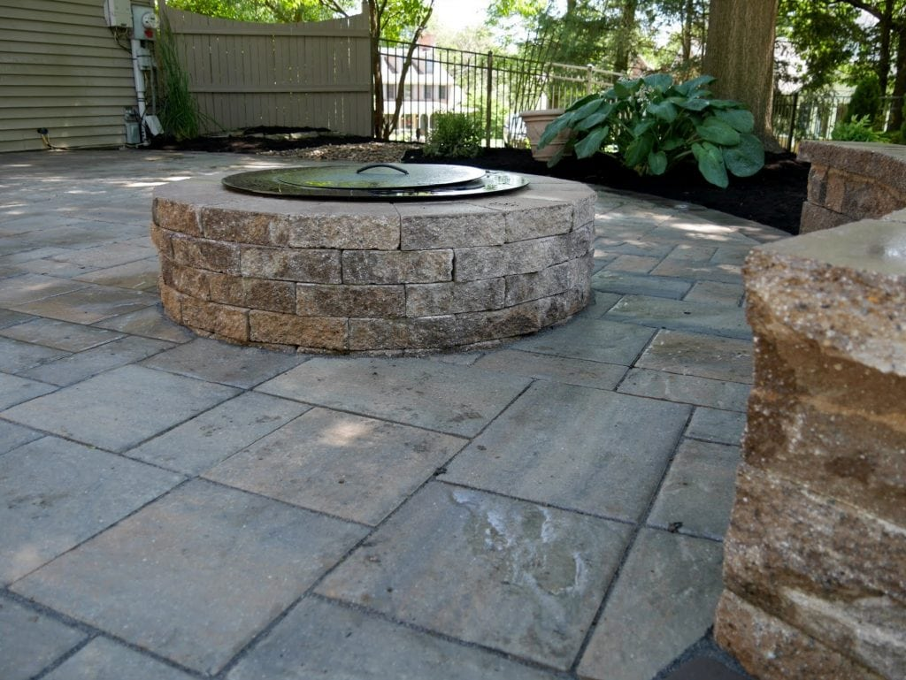 Here is a shot of a stone patio installation project we completed in harrisburg PA. This image shows a covered fireplace that was also installed at the same time.