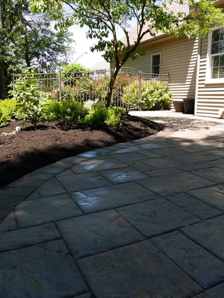 Here is a shot of a stone patio installation project we tackled in Harrisburg PA. This image shows beautifully carved stone laid out on a curved patio.