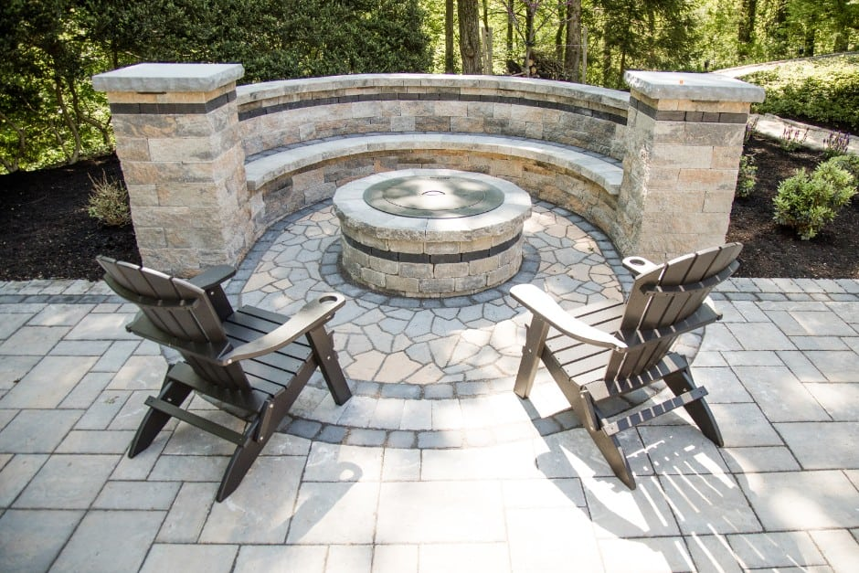 Check out this stone patio installation project we recently finished, complete with a fire pit! This took place in camp hill PA. This image shows two lawn chairs at the pit ready for someone to enjoy.