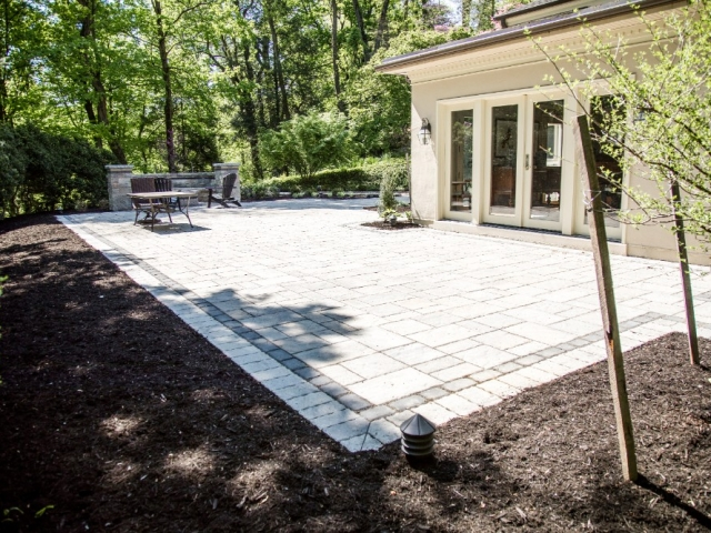 This image shows the home of a stone patio installation project we recently completed. This stone patio is large and wraps around one corner of the home. As one of the top stone patio installation companies in camp hill PA, we go above and beyond our clients requests. This image also shows fresh mulch surrounding the area.