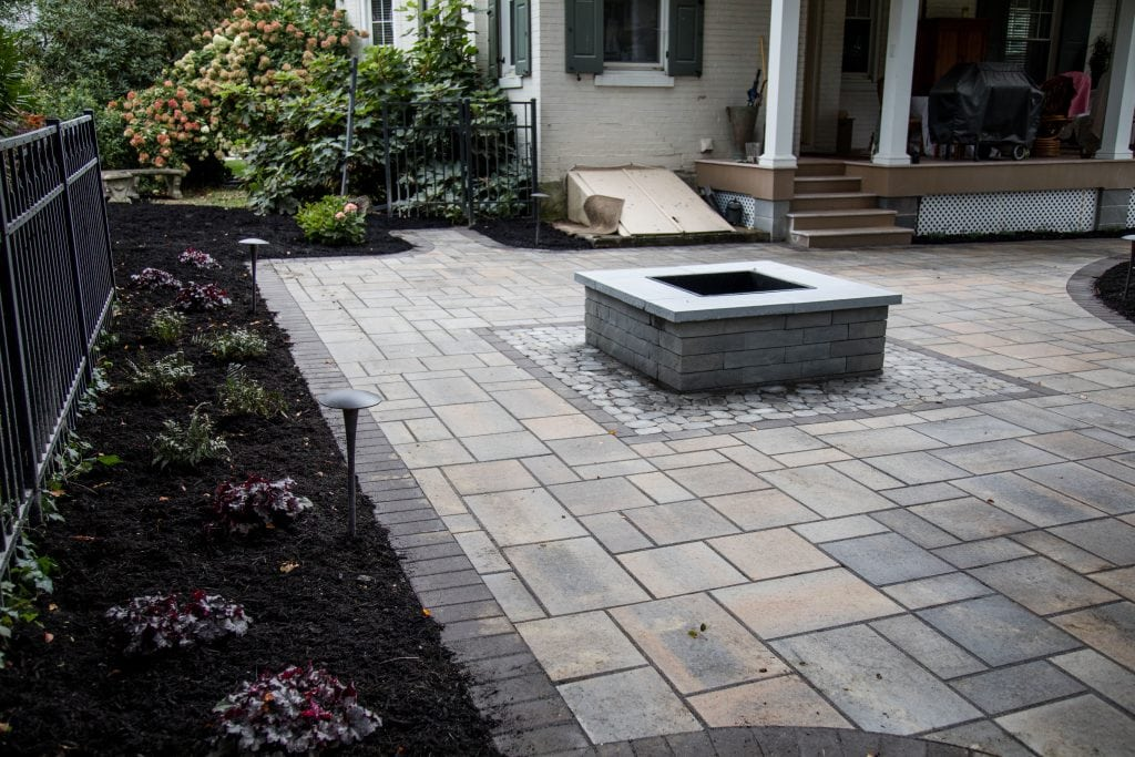 Here is a stone patio installation project we completed. We are one of the top companies in Harrisburg PA for landscape design. Here you also see a stone fireplace in the center of the patio with fresh mulch surrounding the area.
