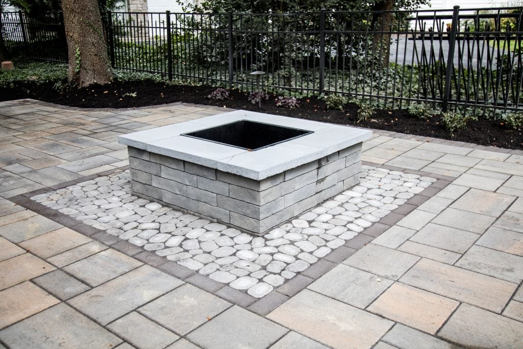 We are one of the top stone patio installation contractors in Harrisburg PA. This is an image of a project we recently completed. In the center of the stone patio is a stone fireplace.