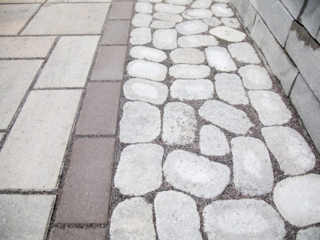 Here is a project out stone patio installers completed in Harrisburg PA. This is a close up shot of the stone that was laid down. There are two patterns being used for this design.