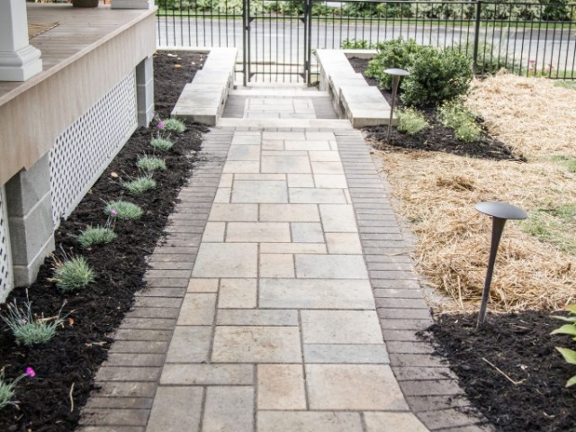 This is a walkway installation project we recently completed in Harrisburg PA. This image shows the walkway going along the side of the home towards the road.