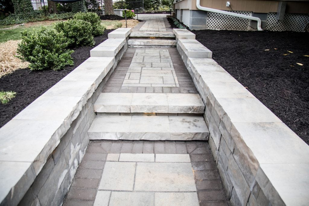 Here is another angle our walkway installers in harrisburg pa completed. This shows plants on the left side of the walkway.